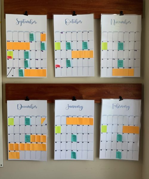 rinted and Laminated Wall Calendar in Office